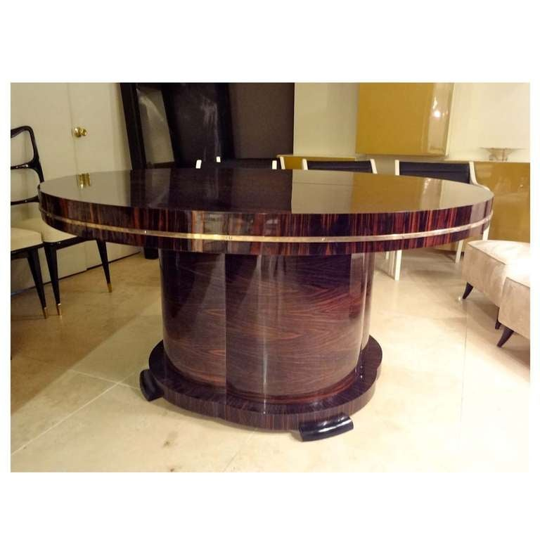 A large round extending art deco dining table by j for Table de nuit art deco