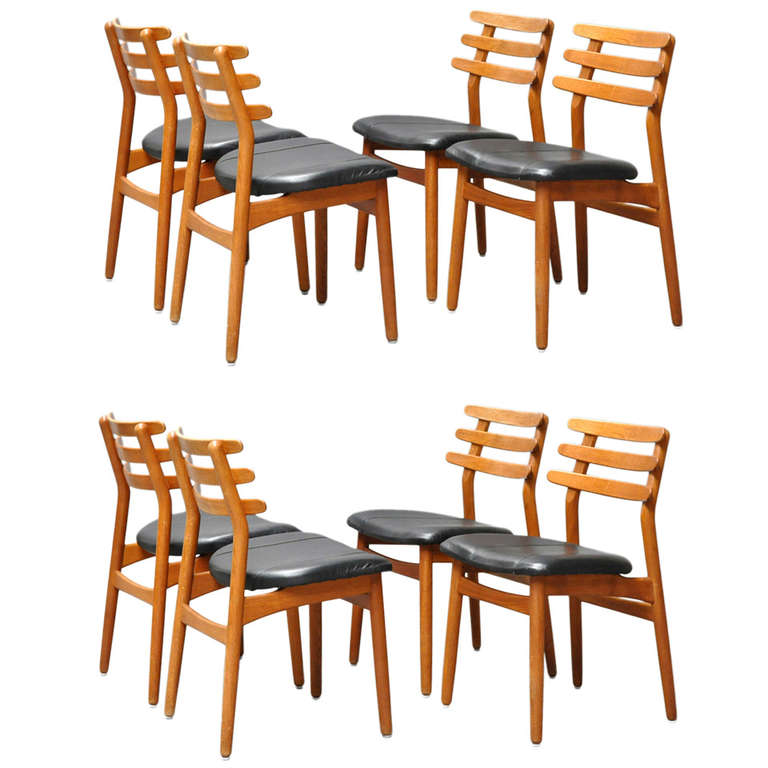 set of eight oak dining chairs by danish designer poul volther for