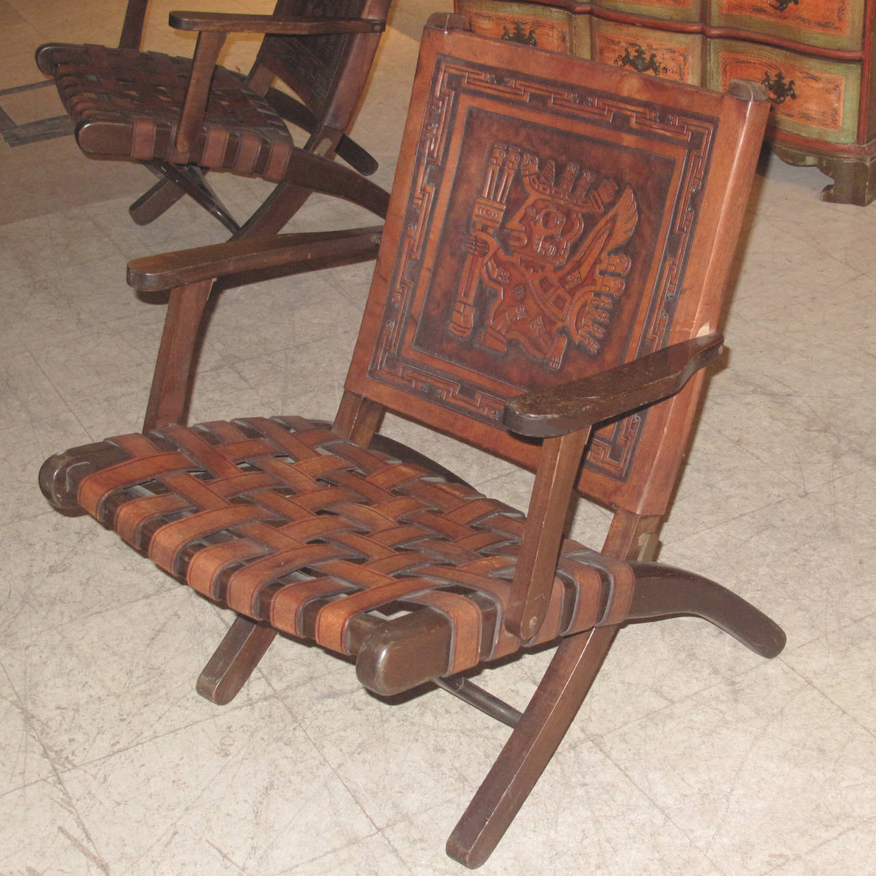 Pair Of Folding Leather And Wood Frame Armchairs. Each Leather Chair Back  Hand Tooled