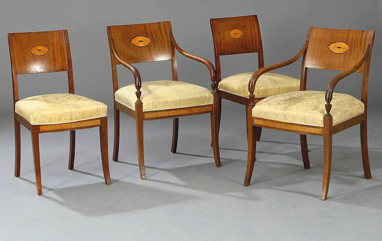 The set consisting of 2 side chairs and two armchairs.  The chairs of mahogany with satinwood and exotic wood inlay.