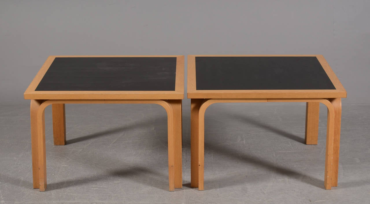 Pair of Danish laminated and molded beechwood low tables with inset ebonized wood tops. Designed by Danish architects Rud Thygesen and Johnny Sorensen, circa early 1970s.