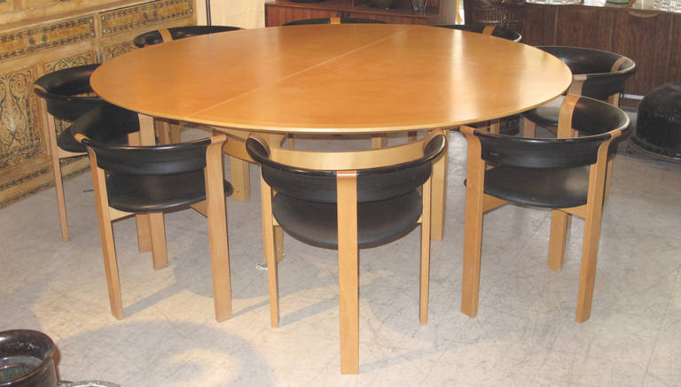 a large circular maple dining table with eight barrel back dining chairs of beech with danish dining table and eight chairs by johnny sorensen and rud      rh   1stdibs com