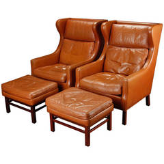 Pair of Large-Scale Danish Modern Leather Wing Chairs and Ottomans