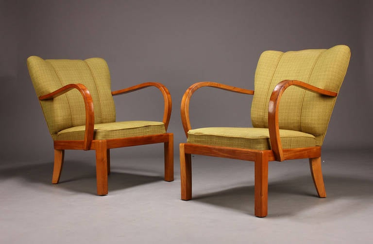 Pair of Danish Modern 1930s-40s Armchairs with Exaggerated Curved Arms; the frames of Elm Wood.  Note:  Chairs need to be reupholstered.