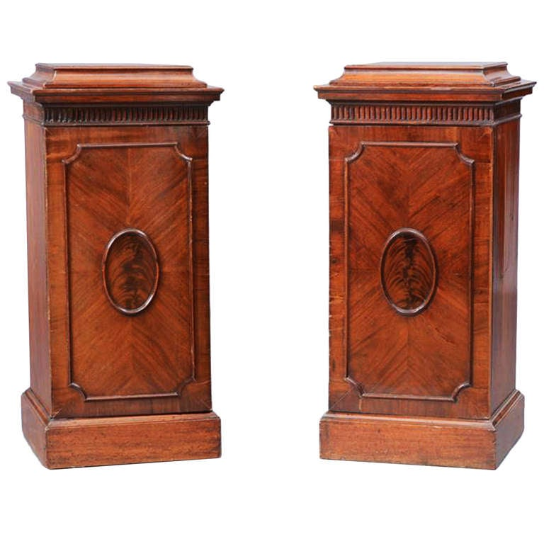 A Pair of George III Figured Mahogany Pedestals