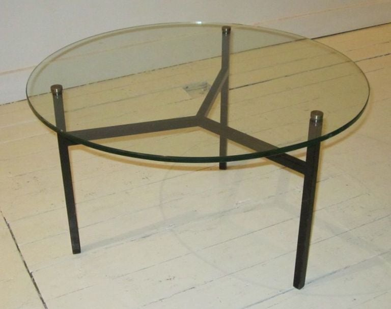 french round glass top with black iron base coffee table at 1stdibs
