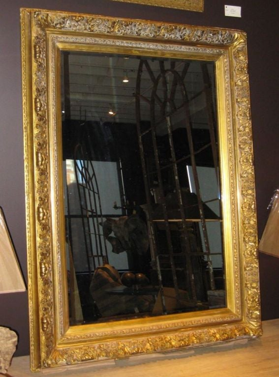 19thc large gold guild framed mirror at 1stdibs for Big gold mirror