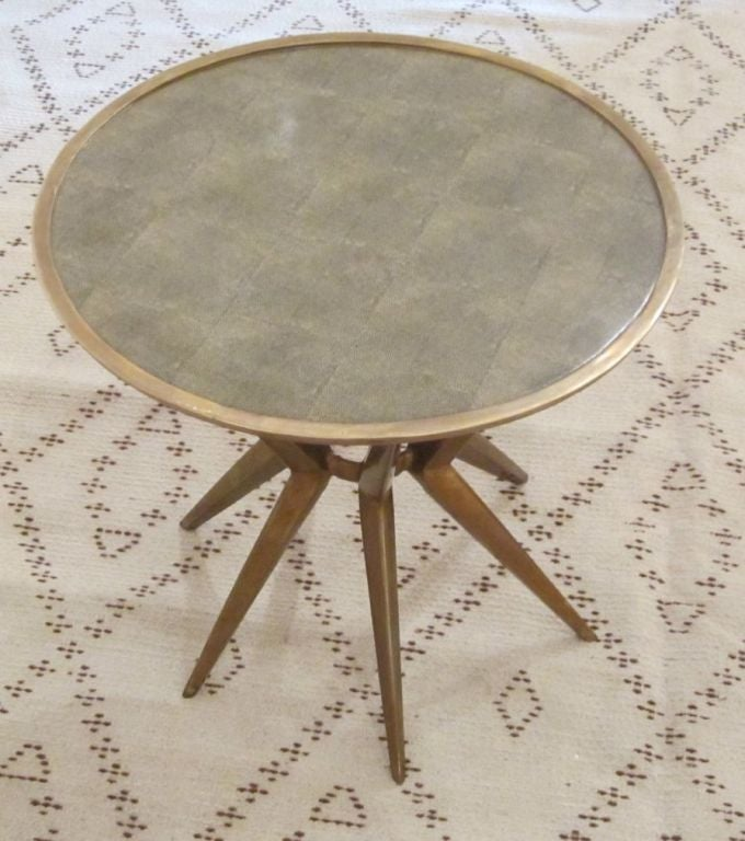Faux shagreen green print transfered onto a round porcelain top with brass base. Brass trims the top. Great small side or cocktail table. ARRIVING END MARCH