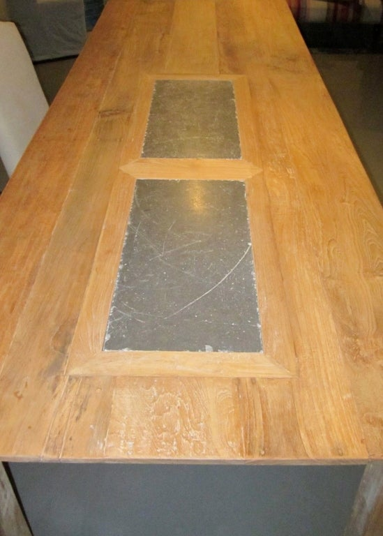 this teak dining table with bluestone insets is no longer available
