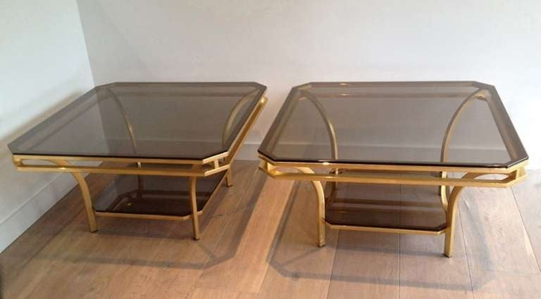 Two-tiered brass frame and smoked glass square coffee tables.