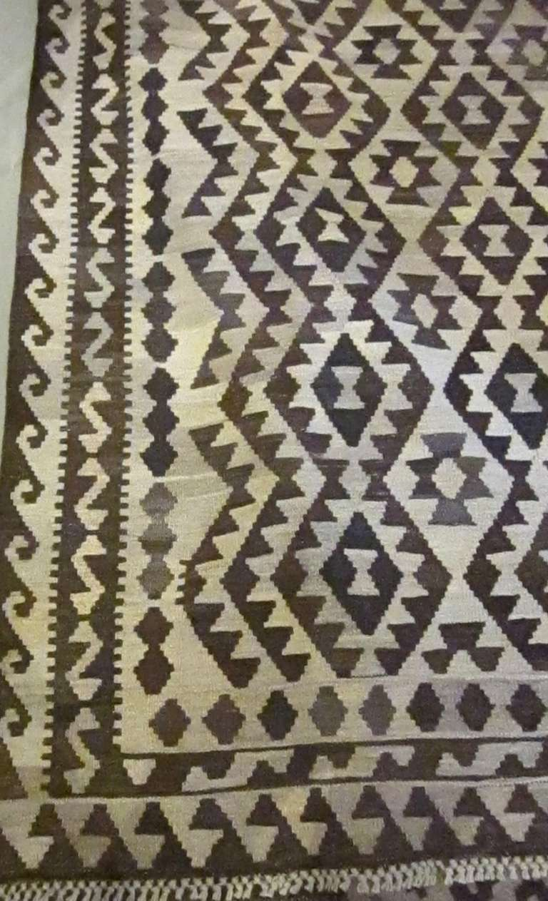 Vegetable dyed dark brown and cream Kilim. Made in Eastern Europe.
