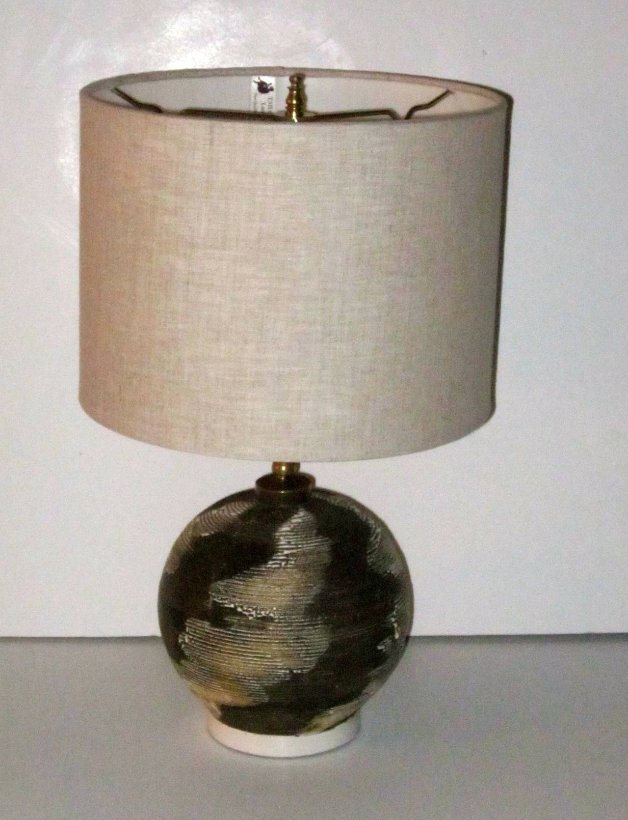 1940s French brown and cream textured small desk lamp. The six inch diameter lamp has a textured globe pattern and a natural color linen shade.
