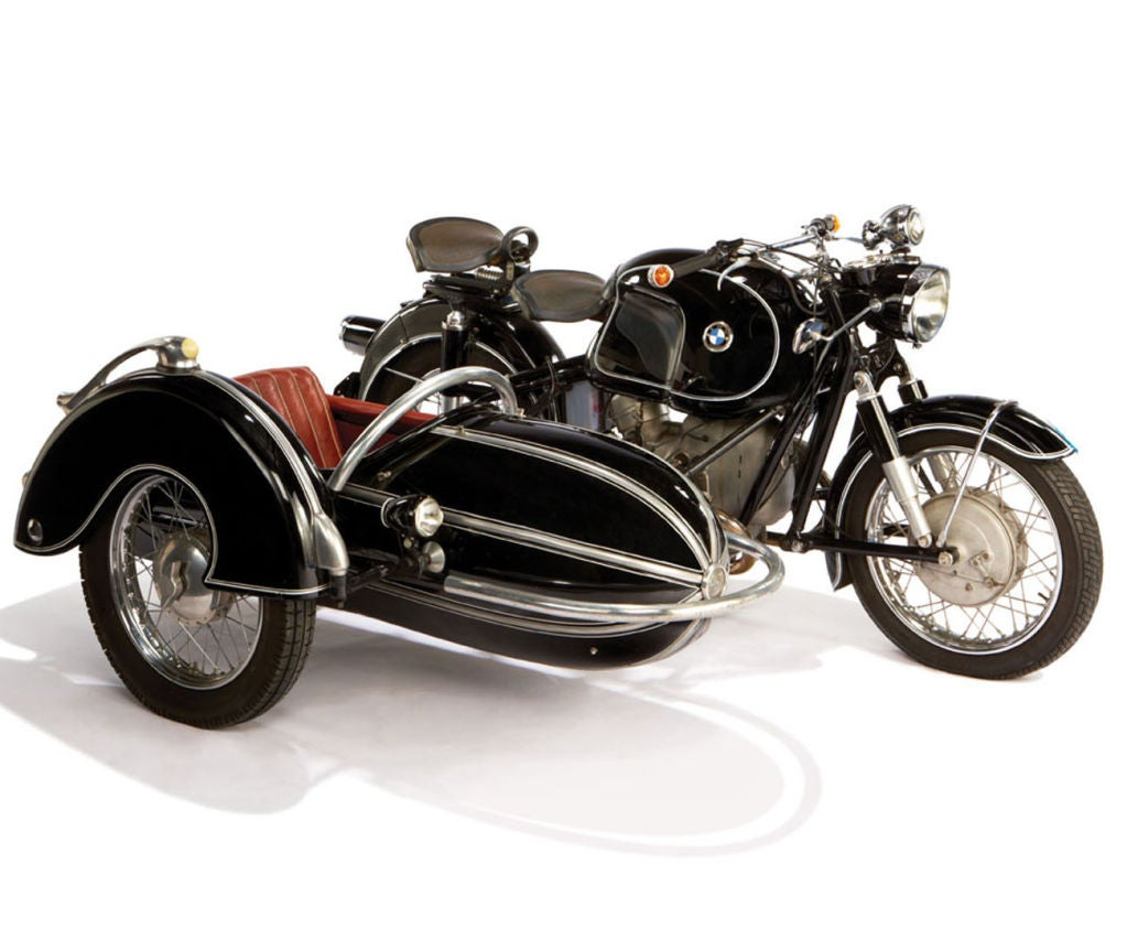 In 1956, ten years after BMW resumed motorcycle production, they released the R60, a low compression model that was favored by sidecar drivers. The classic Steib sidecar, with its' Zeppelin - style design, is a flawless accompaniment to BMW's