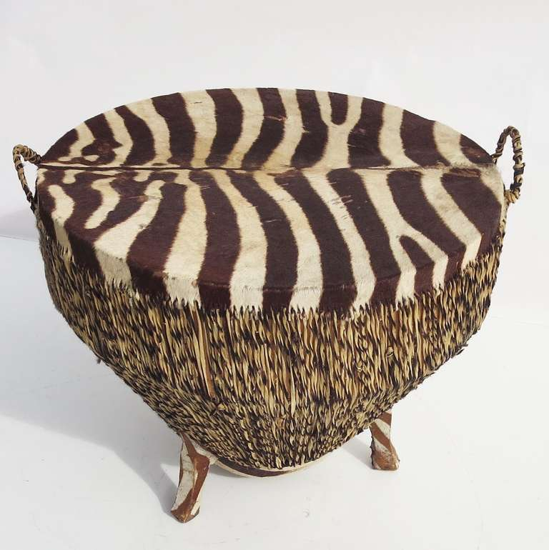 A stylish and exotic statement table, indeed! The drum form is covered in zebra hide, stitched together with zebra rawhide strips. The strips are applied wet, and stretched tight. As they dry, they shrink and tighten even more, adding the