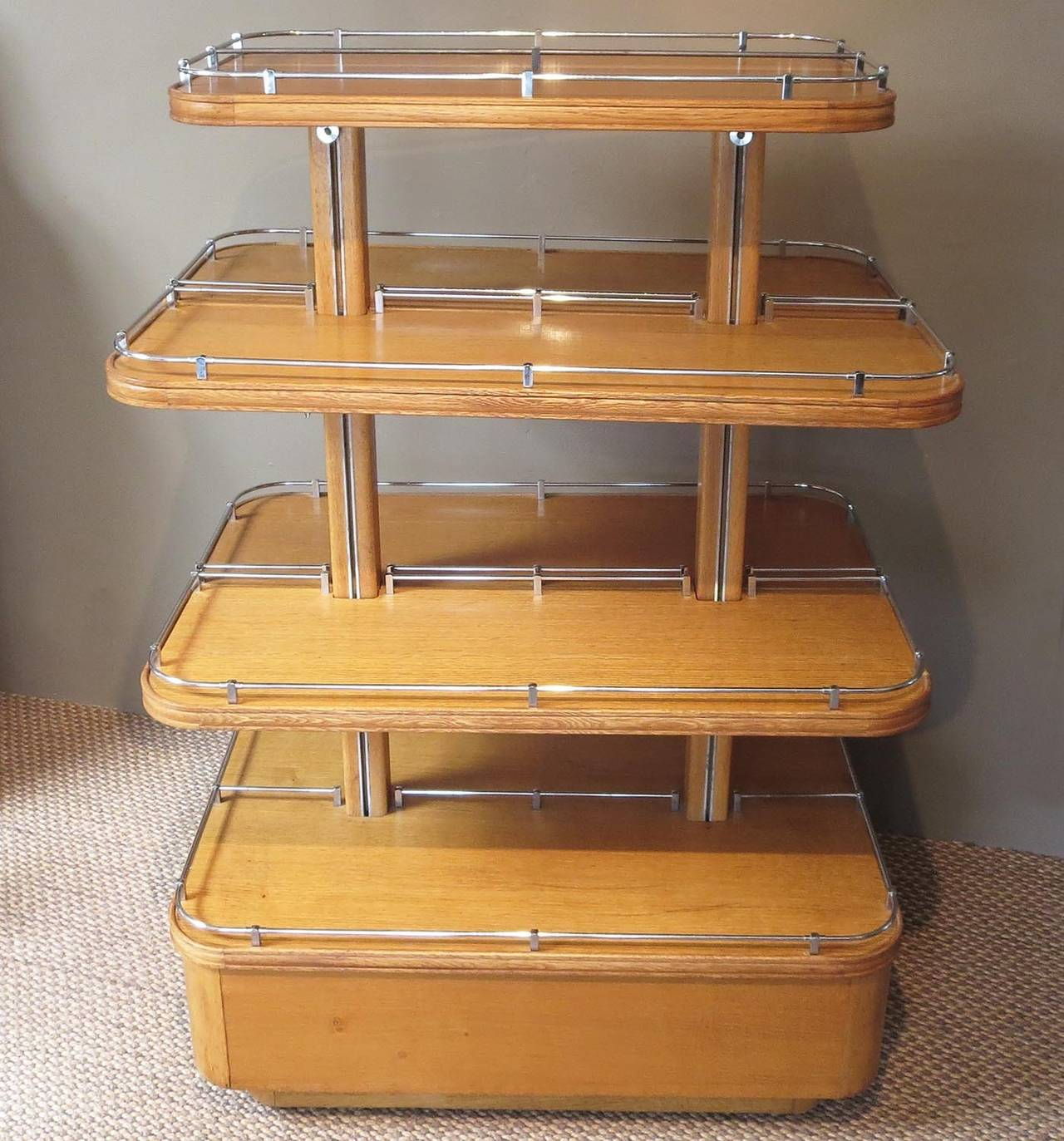 Although this ocean liner influenced tower can be used for any number of objects, it would be best served as an open display for shoes in a dressing room. Each of the two center shelves are adjustable in height, with the top and bottom units fixed