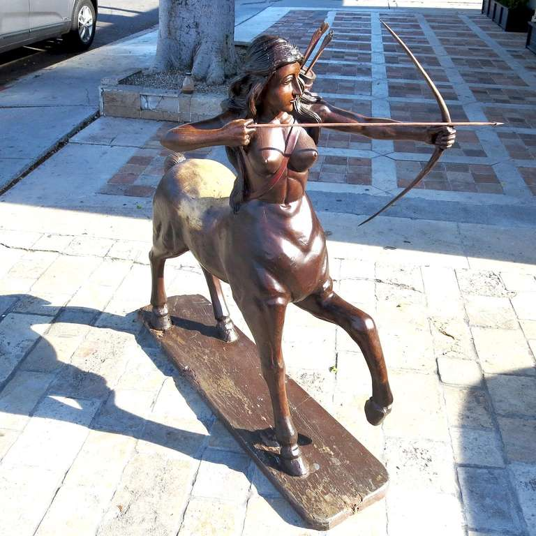 This beautiful sculpture is all finely carved and polished solid wood. The lovely lady is poised to fire an arrow, while four more await in her quiver. The work is unsigned, but the quality of the work suggests an artist of great talent. The statue