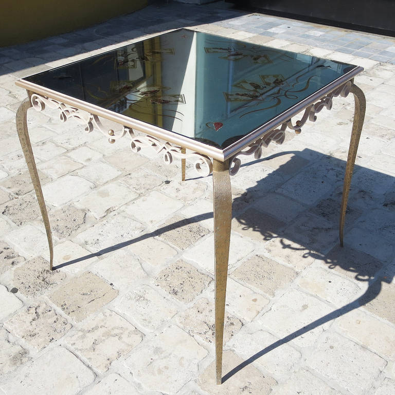 RETIREMENT SALE!!!  EVERYTHING MUST GO - CHECK OUT OUR OTHER ITEMS.  This wonderful table has the hallmarks of a Rene Drouet design, but is not yet documented. The svelte curved legs and stylized lattice-work in the metal are finely executed,