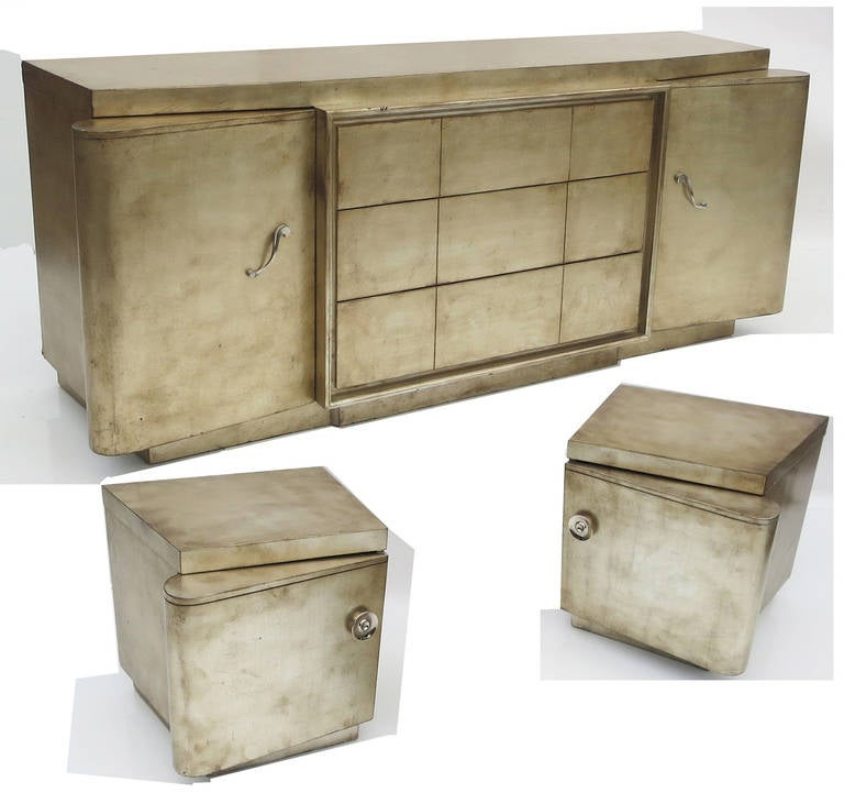 This fantastic set reflects the designs of James Mont, Billy Haines, and Samuel Marx. Each item is finished in a silver leaf, with a hand rubbed burnishing under clear lacquer. Both the dresser and night stands feature a most unique door design,