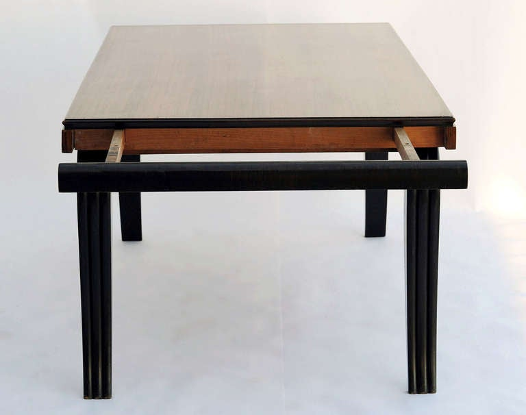 This fantastic set features the table, with two extensions, and eight leather covered chairs. The set is attributed to Jules Leleu, but not documented. The set displays beautifully, with sweeping, lyrical legs, and a top of Macassar ebony wood. The