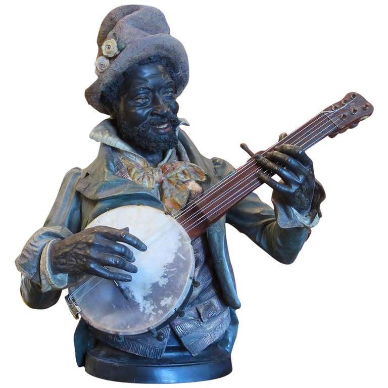 Goldscheider Polychromed Ceramic Minstrel with Banjo For Sale