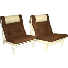 Pair of brown suede and oak lounge chairs by Bernt Petersen