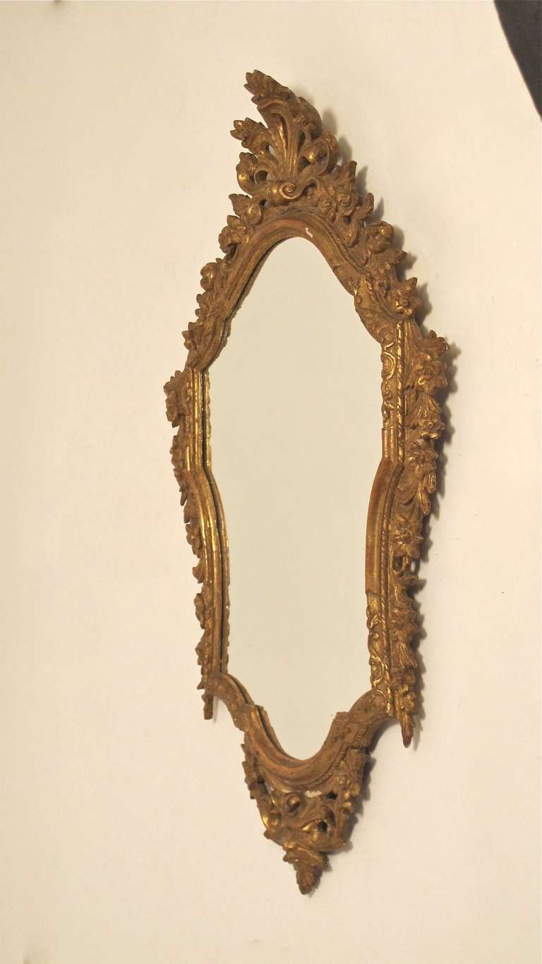 Hand-Carved Pair of 18th Century Italian Giltwood Mirrors For Sale