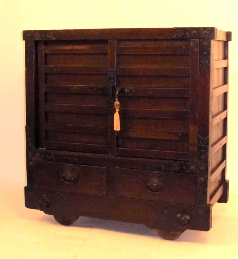 """This impressive Edo period tansu was made in the early to mid-19th century. It is a difficult to find Classic merchant's chest with the door slats in the """"stone - tatami"""" pattern reserved for influential or privileged merchants. The hand-wrought"""