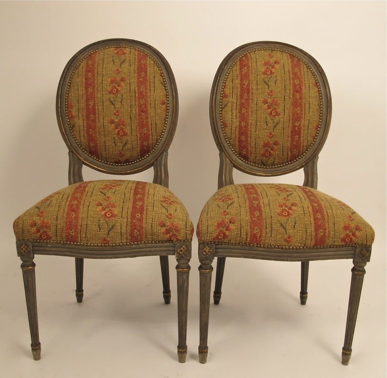 Set of four Louis XVI style carved and painted side or dining chairs. In good original condition with original paint. Vintage upholstery is in good condition. Chairs are sturdy and sound, France, early 20th century.
