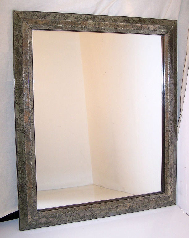 An exceptionally nice quality Italian mirror. Marbleized mirror frame with all edges beveled, and having an ebonized wood trim around the outside. Italy, mid 20th century.