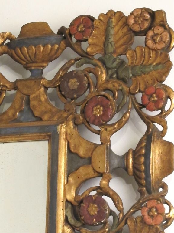 Beautifully carved walnut mirror with original paint. Can hang vertical or horizontal. Italy, early 20th century.
