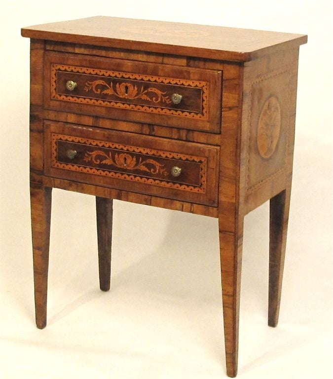 A small two-drawer walnut comodino or side table with exceptional marquetry inlaid design and rich warm patina, Italy, 18th century.