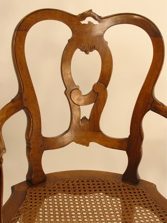 Pair of Italian Carved Walnut and Caned Armchairs In Excellent Condition For Sale In San Francisco, CA