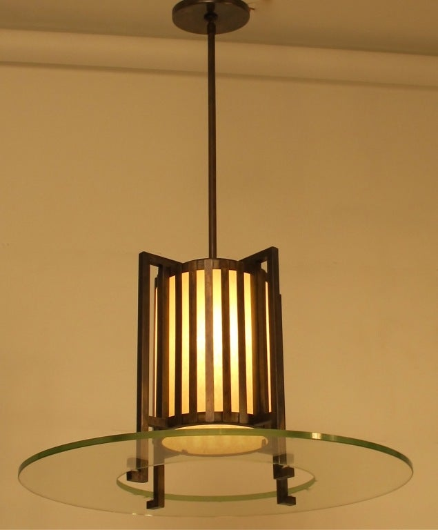 Quality bronze and glass light fixture, having a bronze cage and original glass disc. Newly-rewired. American, mid-20th century.