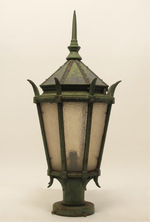A large antique cast iron street light fixture with textured glass panels, made by General Electric. Having beautifully weathered old green paint (possibly original). American, late 19th-early 20th century.
