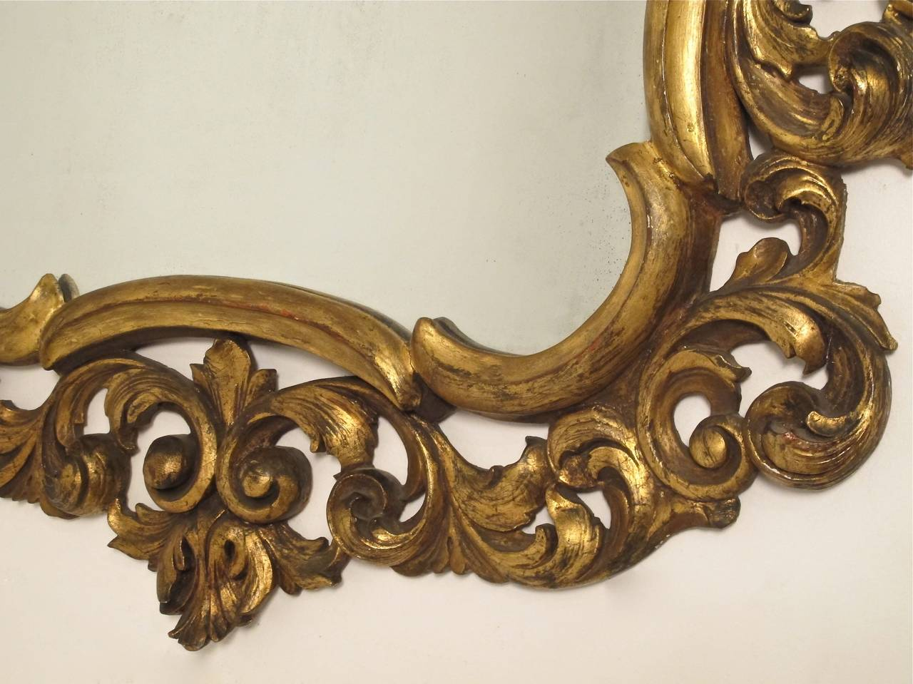 Carved Italian Rococo Style Giltwood Mirror For Sale