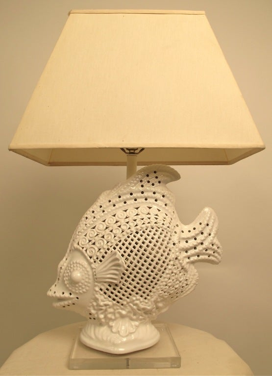 A very large cast ceramic and hand modeled fish lamp with hand cut open work.  Measurements include shade. Italy, mid 20th century.