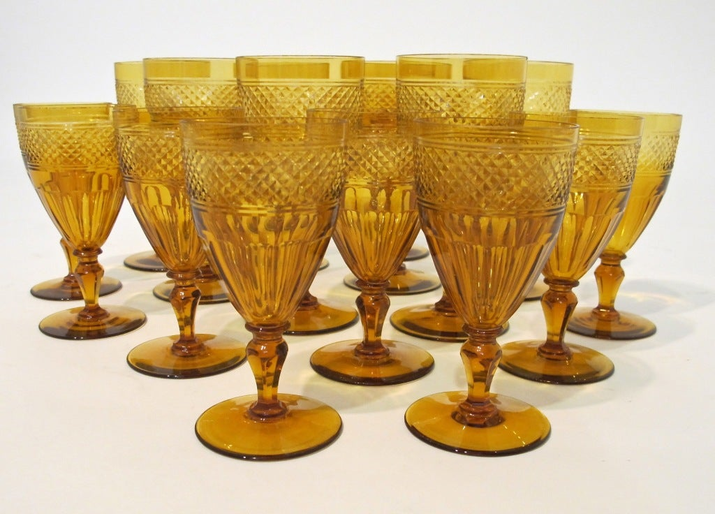 Extremely fine wheel cut crystal glasses in a lovely warm amber color. Moser or Baccarat quality. Set includes 8 water and 8 wine glasses.