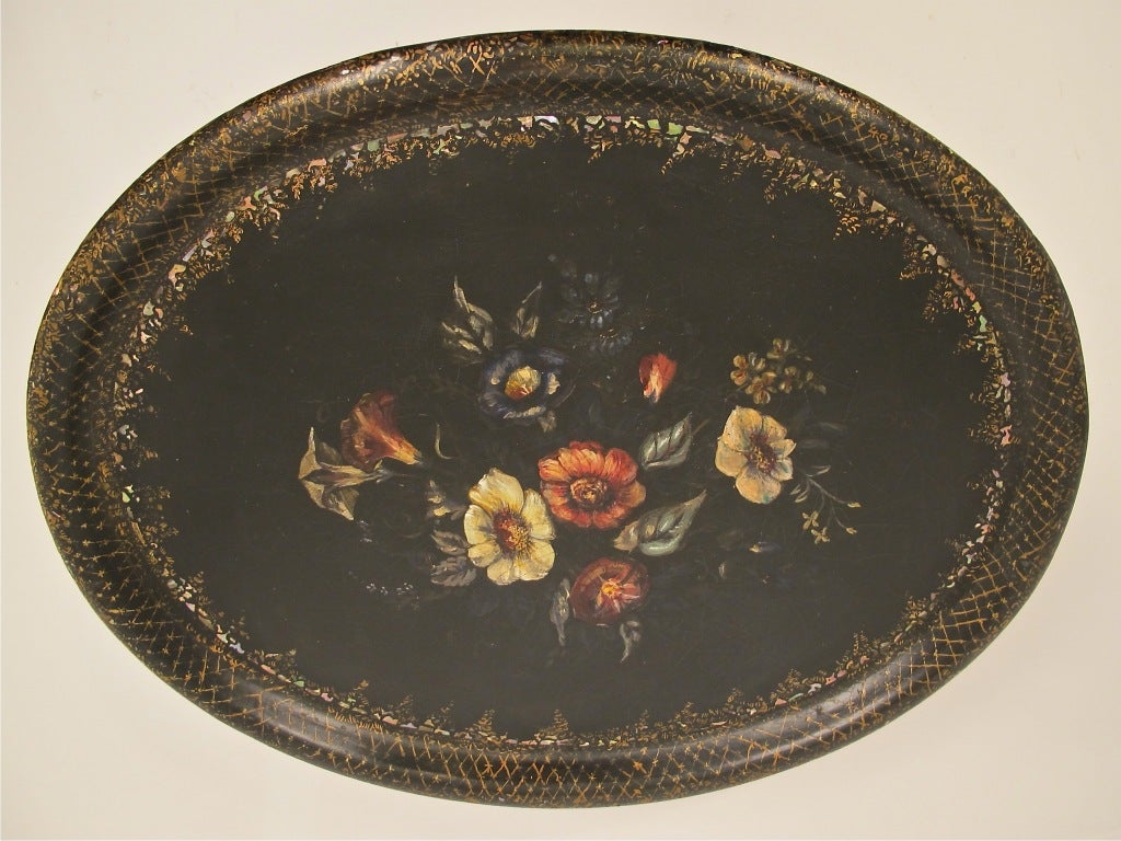 Beautifully hand-painted paper mâché tray with flowers and mother-of-pearl inlay, supported on later custom-made table base.