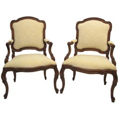 Pair of 18th Century Italian Rococo Walnut Fauteuils