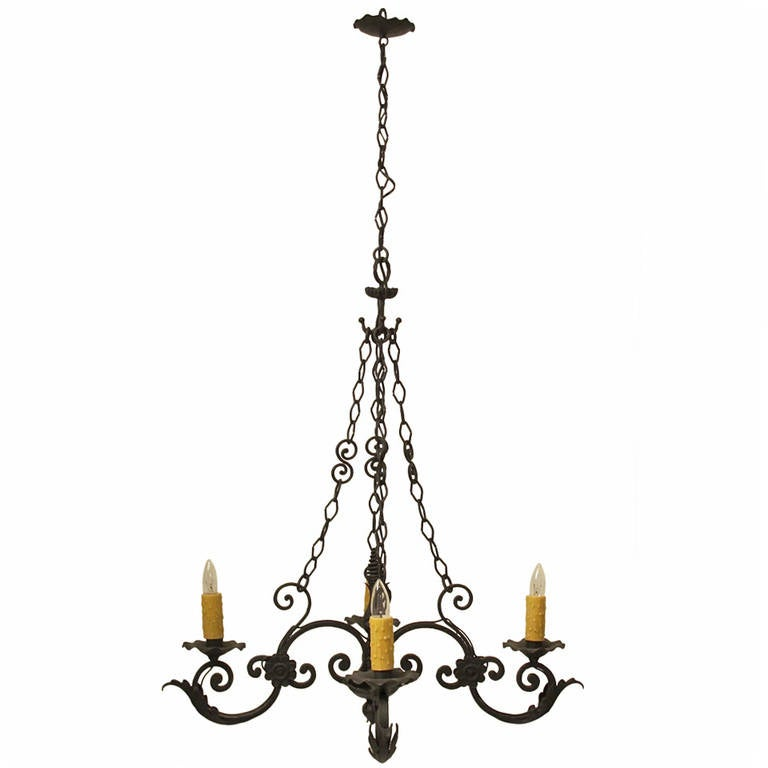 this spanish wrought iron light fixture is no longer available. Black Bedroom Furniture Sets. Home Design Ideas