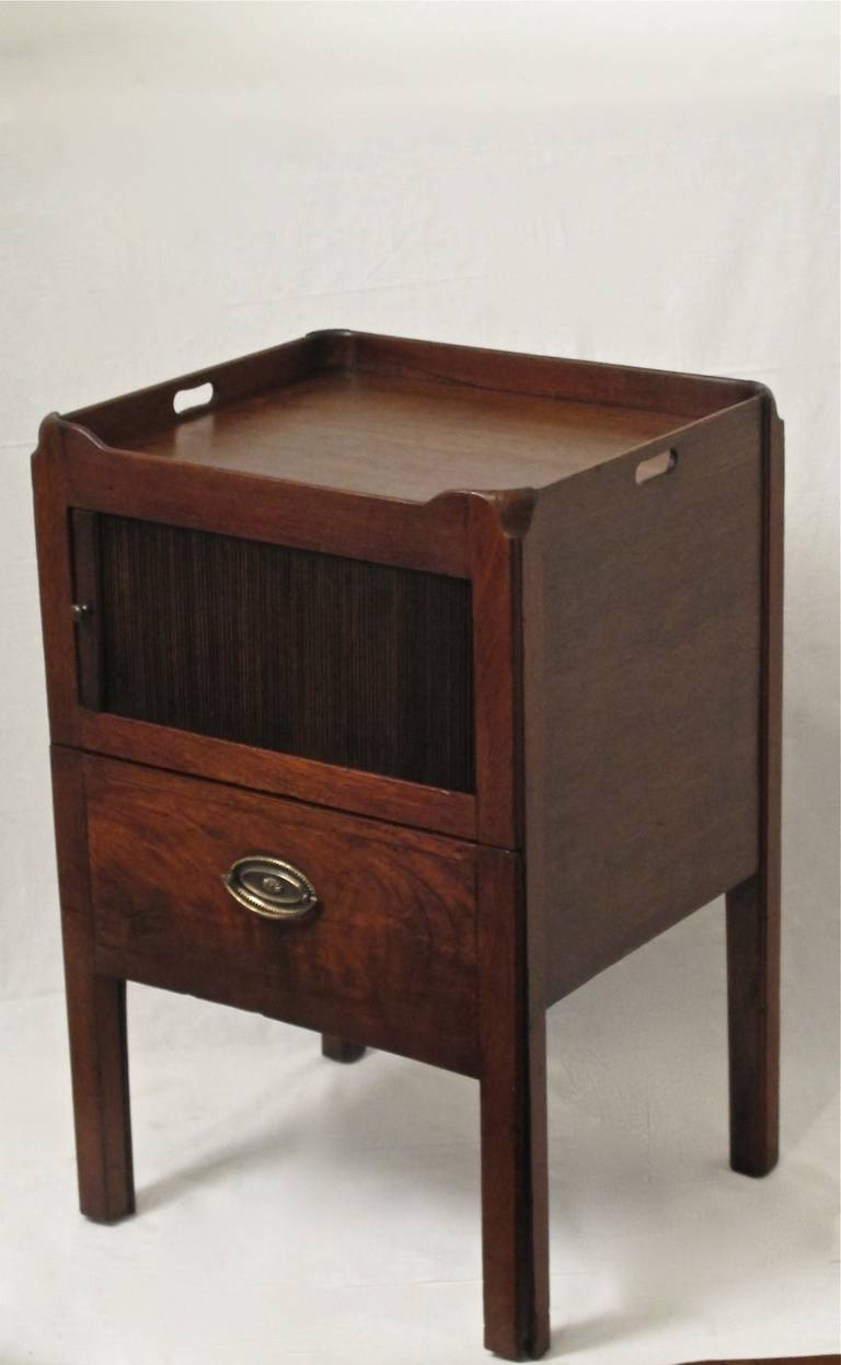 Georgian period mahogany bedside cabinet or commode with tambor cabinet  door and single drawer. England, 1780-1820.