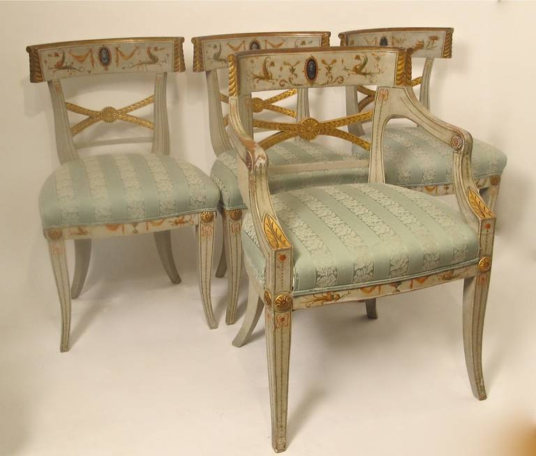 An extraordinary set of eight dining chairs (two armchairs and six side chairs). Having original painted detail inspired by Pompeian paintings. Upholstered in the 1950s or 1960s. Adam style, possibly English. Early 19th Century. Armchairs measure 33