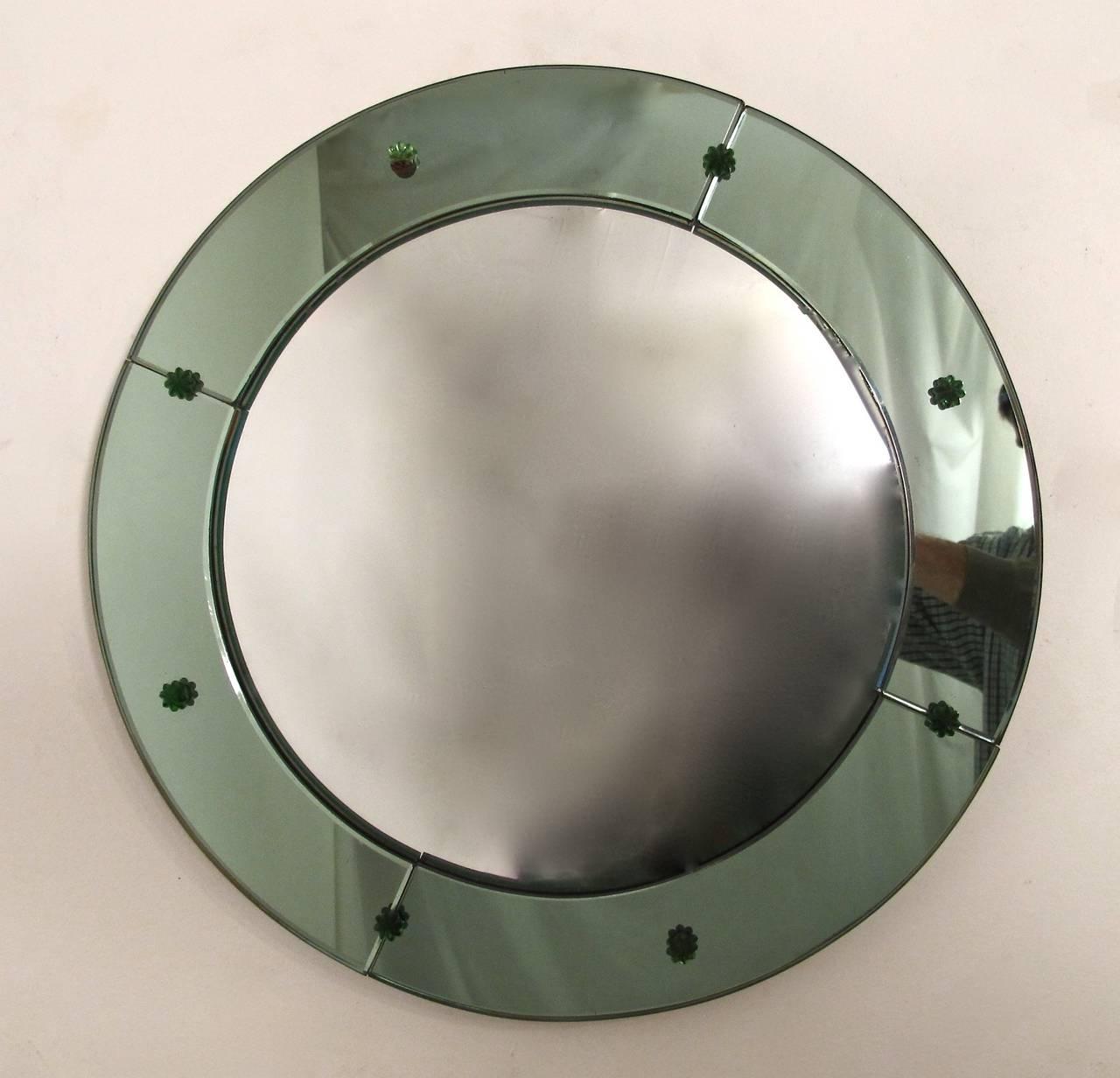 An unusual Art Deco period green glass frame with convex or fisheye mirror.
