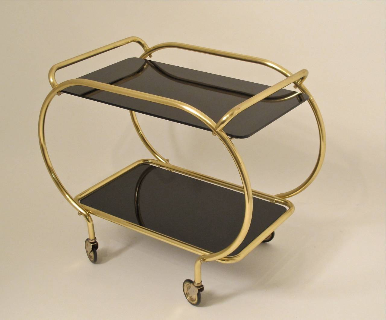 An unusual brass and vitrolite (black glass) bar or serving cart, American, 1930s-1940s.