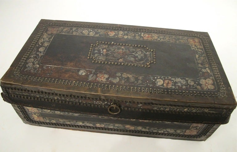 Smaller size hand painted pigskin covered camphor wood trunk with metal nailhead and trim detail. China, early 19th century.
