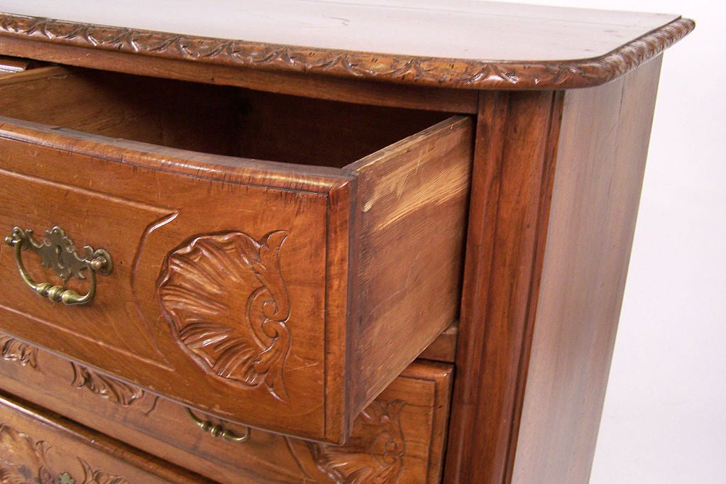 Beautifully carved solid walnut four drawer commode or chest of drawers. French or possibly Swiss, mid to late 18th century.
