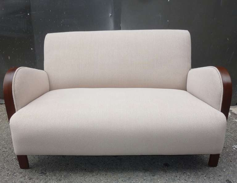 Settee new reupholstered in cotton Italian upholstery material. Dark walnut color wood all together wonderful.