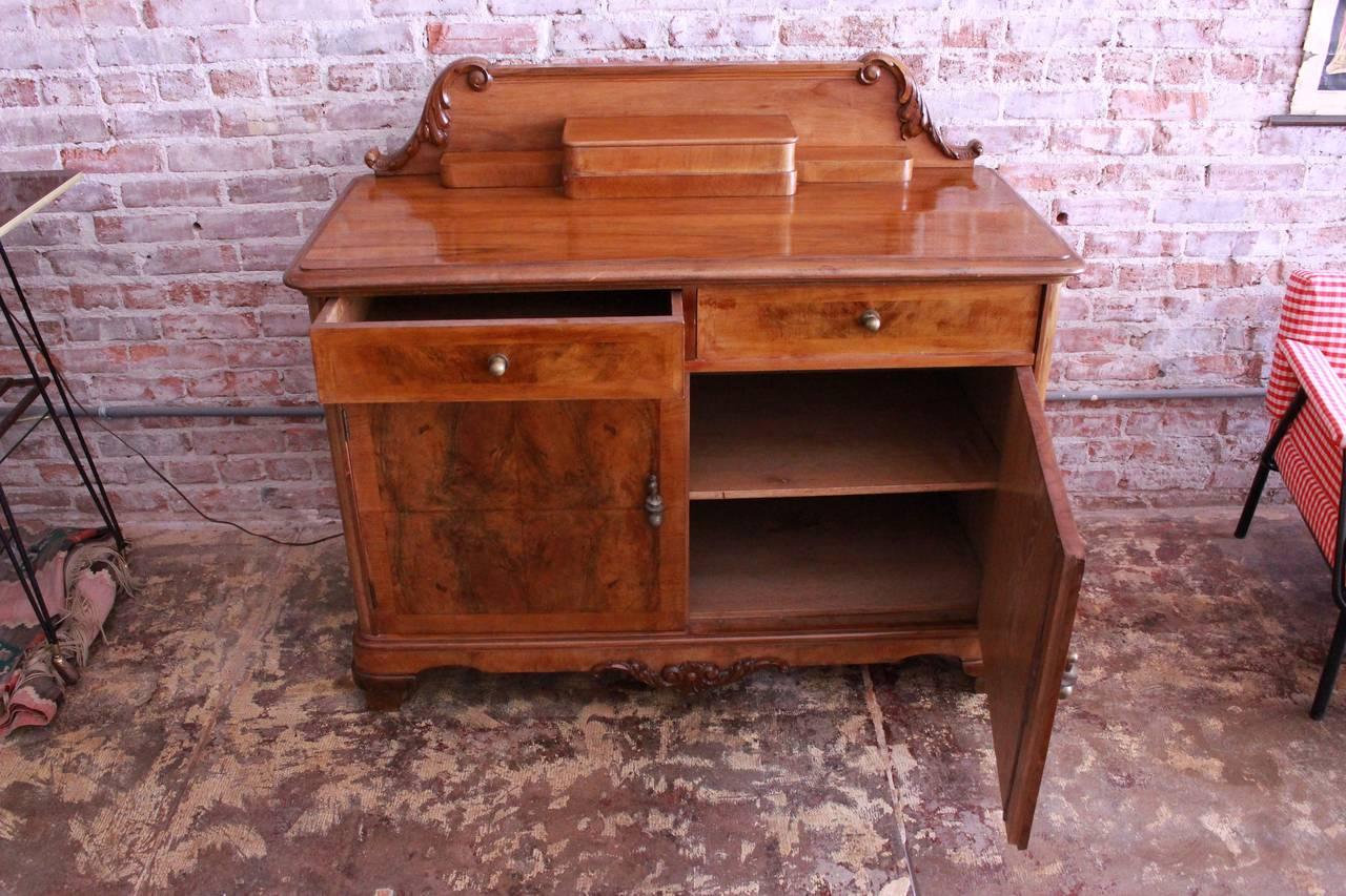 Walnut wood and walnut veneer cabinet.  Back height is 43.5.