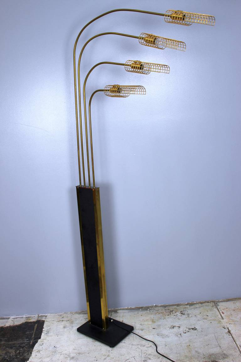 1970s brass floor lamp dimmer on the lower part of the lamp.
