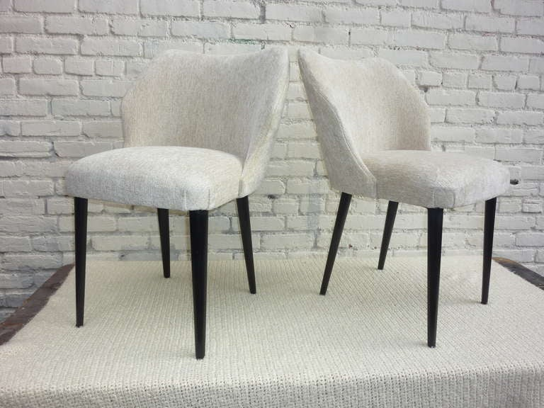 Italian pair of chairs by Cantoni Udine. Reupholstered in white cotton by Eger. Sign on the bottom.